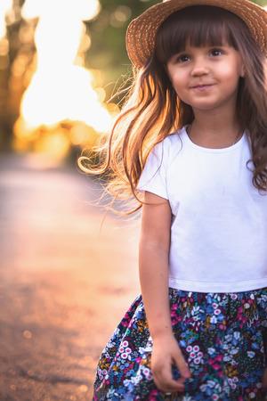 Summer outdoor portrait of beautiful happy child