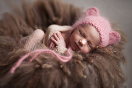 Closeup infant baby girl sleeping at background. Newborn and mothercare concept