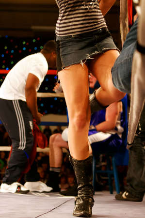 battleground: Boxing ring, girl and trainer Stock Photo
