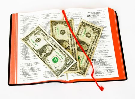 commercial law: open bible and money