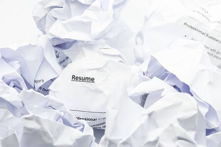 Concept of resume crumpled up and thrown away in the trash. Stock Photo