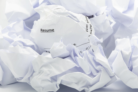 Concept of resume crumpled up and thrown away in the trash.