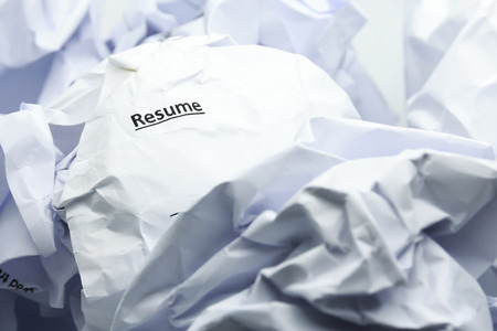 discard: Concept of resume crumpled up and thrown away in the trash. Stock Photo