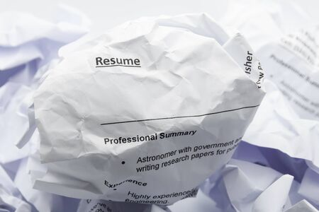 Resume crumpled up and thrown away in the trash concept Stock Photo