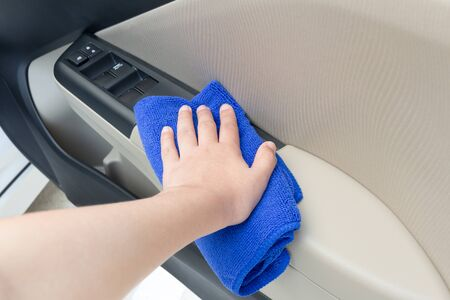 microfiber cloth: Hand cleaning interior car door panel with microfiber cloth concept Stock Photo