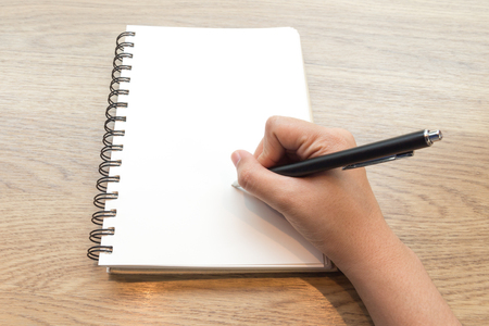 place to learn: Concept of Woman hand writing on notebook Stock Photo