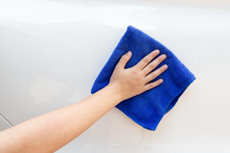 microfiber: Cleaning car using microfiber cloth. Stock Photo