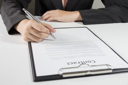 Business woman signing contract document form.