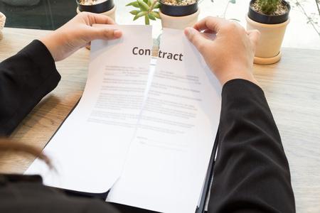 Businesswoman ripping up a contract concept. Archivio Fotografico