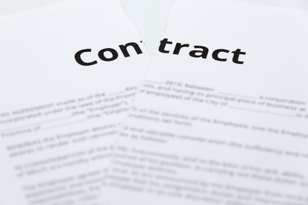 broken contract: Close up of ripped up contract. Stock Photo