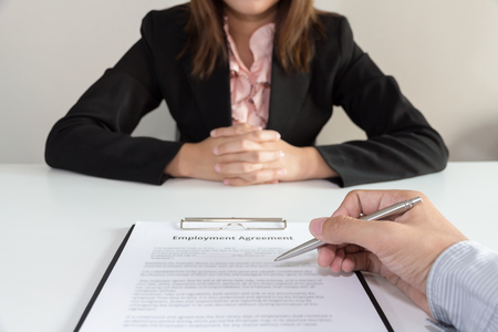 harmonize: Businesswoman make a decision to sign the  employee agreement contract.