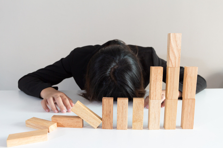 bearish market: Stressed businesswoman with simulate stock market took a nosedive.