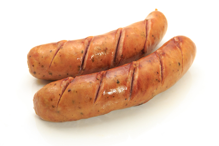 cooked sausage: Two smoked sausages on white background. Stock Photo