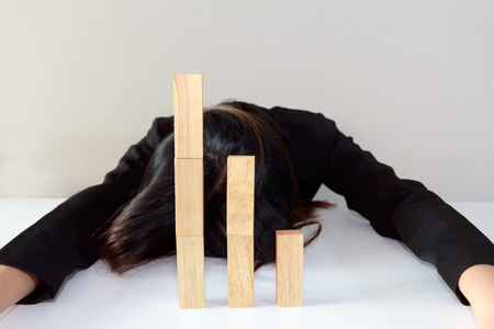 plummet: Stressed businesswoman with simulate stock market took a nosedive.