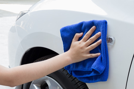 microfiber: Woman cleaning car using microfiber cloth. Stock Photo