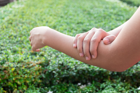 stiffness: Woman arm pain.
