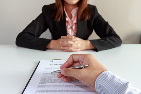 harmonize: Concept of Businessman make a decision to sign the employee agreement contract