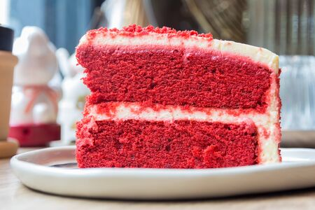 layer cake: Piece of red velvet layer cake with cream cheese frosting