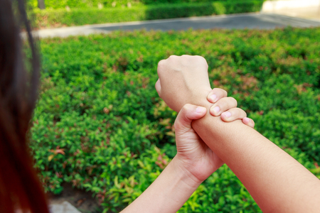 holding in arm: Woman hands pain or holding arm in garden concept