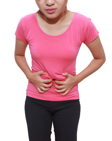 Asian woman touching her own belly with stomachache, appendicitis pain isolated on white background