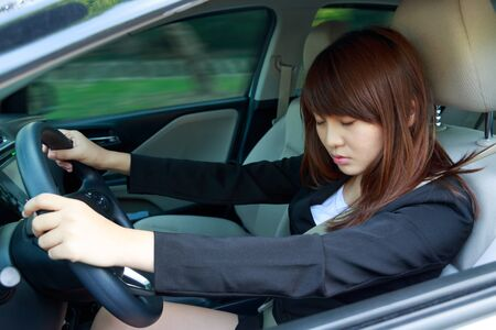 Closeup portrait sleep, tired, close eyes young woman driving her car after long hour trip, Sleep deprivation, accident concept Stock Photo