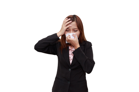 Businesswoman with allergy or cold sneezing into napkin with headache - health isolated on white background Stock Photo