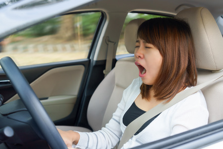 Closeup portrait sleepy, yawn, close eyes young woman driving her car after long hour trip, Sleep deprivation, accident concept