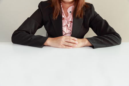 Business woman sitting at desk and waiting for interviewer - interview concept