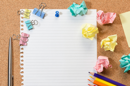 Cork board with blank paper, colorful blank notes, color pencil, tag, trash and push pins.
