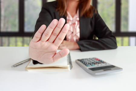 hinder: Business woman says no or hold on at her office.