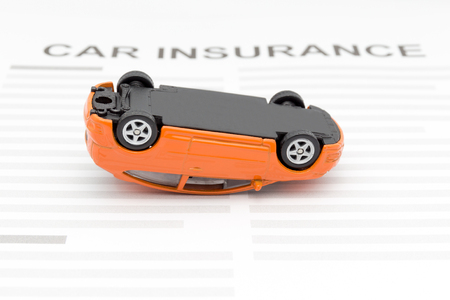 Car insurance concept with accident car toy lay down on desk