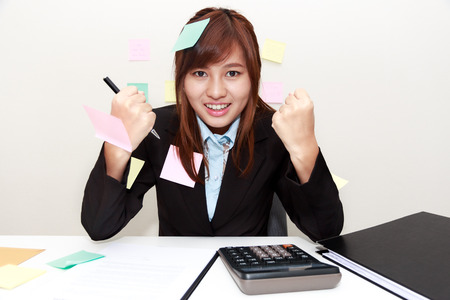 when: Happy excited successful businesswoman with arms up when her work done  in office - business concept Stock Photo