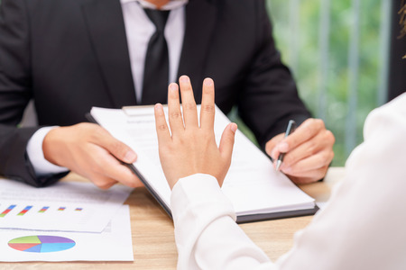 Customer or woman says no or hold on when businessman giving pen for signing a contract. 版權商用圖片