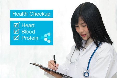 Female doctor or physician writing checklist for diagnosis patient - health checkup concept