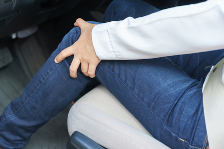 Close up of woman leg with pain - long driving on the way