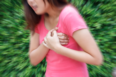 Woman having heart attack at outdoor - Angina Pectoris, Myocardial Infarction.