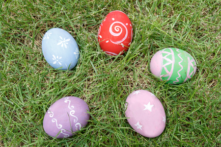 Top view of easter eggs on green grass. Stock Photo