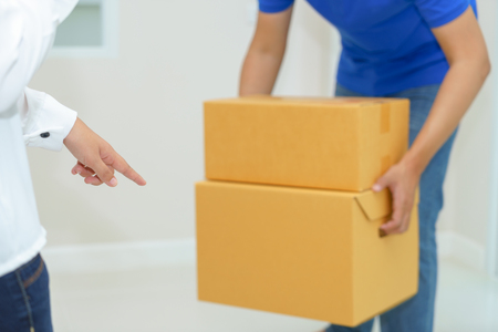 Woman receiving package from delivery man - put it down
