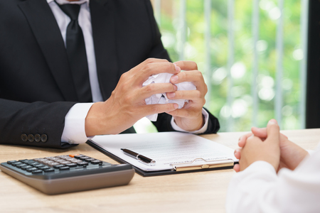 Hands of businessman crumple agreement in font of partner - failure business concept