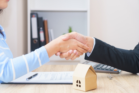 Customer or woman say yes to sign loan contract for buying new home concept - hand shaking.