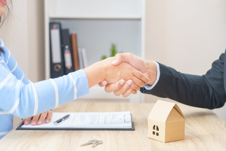Customer or woman say yes to sign loan contract for buying new home concept - hand shaking