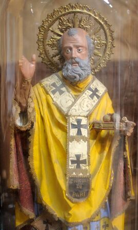 An ancient statue of St. Joseph in the bell jar Stock Photo