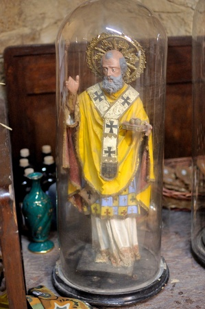 An ancient statue of St. Joseph in the bell jar photo