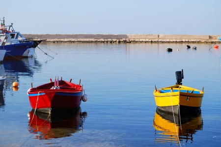 Small boats moored in the harbor of Savelletri in the province of Brindisi - Apulia