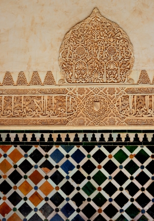 A view of decorative ceramic artwork found on a wall at the Alhambra castle in Granada, Spain. Suitable for an abstract background. photo