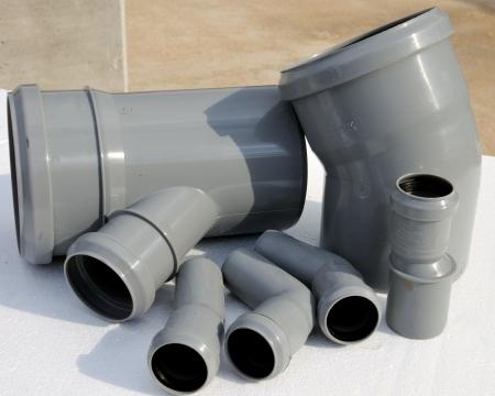 kunststoff rohr: Baustelle - Group of pvc Zierleisten Lizenzfreie Bilder