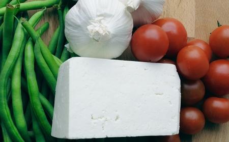 Italian Cuisine - green beans, garlic, cherry tomatoes and ricotta salata