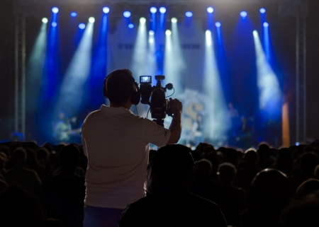 movie production: Cameraman silhouette on a concert stage