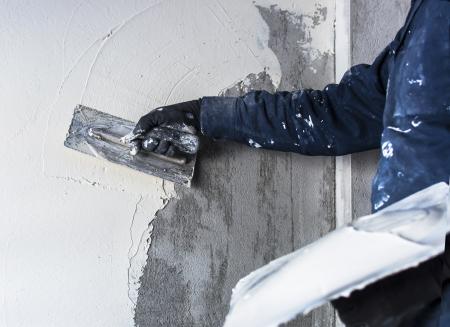Construction site - Worker performs internal plaster Standard-Bild