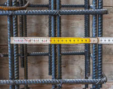 verification: verification wheelbase rebars of reinforced concrete structure with double wooden meter Stock Photo